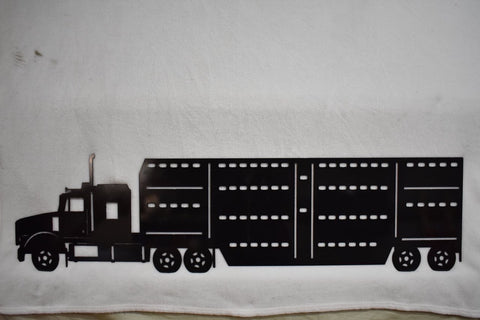 Metal wall art of a black cattle hauler semi truck