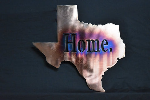 "Copper plated steel wall art of the state of Texas with the text ""Home."" in the middle"
