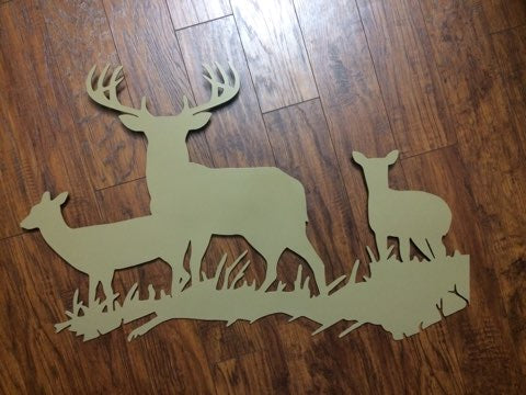 Tan metal wall art of big whitetail buck and does standing in grass