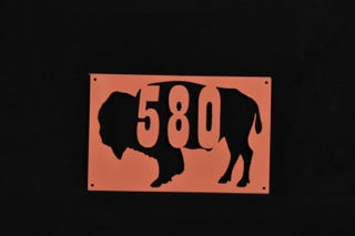 Custom metal wall art of buffalo with 3 digit area code in the middle.