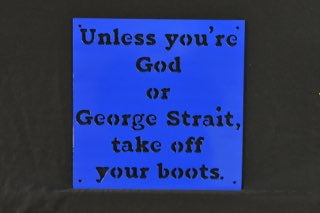 "Metal wall art of sign that says ""Unless you're God or George Strait, take off you boots."""
