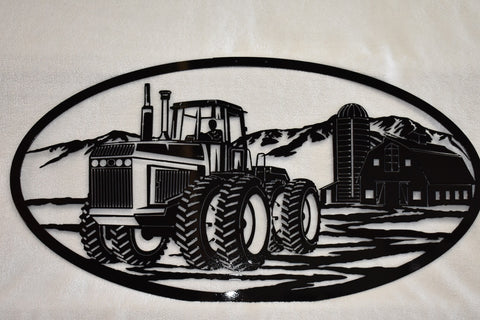 Metal wall art of detailed oval farm scene with large tractor and barn.