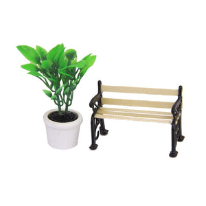 Green Plant in a Pot and Wooden Garden Bench
