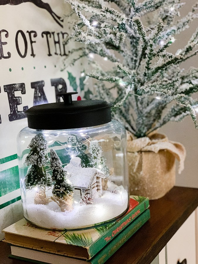 Learn how to create a snowy scene in a jar! It's the simplest vignette to create for the holidays and all winter.