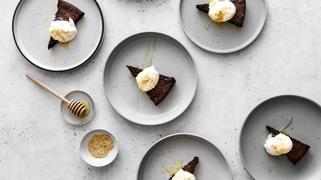 Decadent and chocolatey, with hints of honey and toasted sesame, our Tahini and Chocolate Flourless Cake with Honey Whipped Cream is a simple and elegant gluten-free cake to celebrate any occasion or just-because moments.