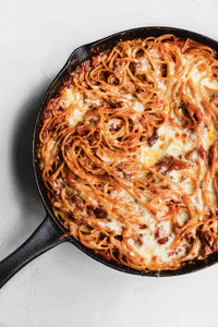 This cheesy baked spaghetti, made with pasta, tomatoes, ground beef or Italian sausage, mozzarella, and Pecorino Romano is a true one-pan wonder that will satisfy even the pickiest eaters at your table.