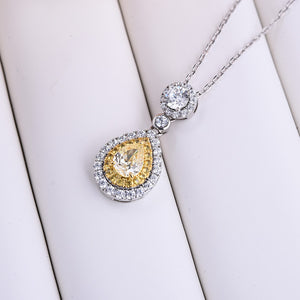 Halo Pear Cut Yellow Sapphire Pendant with Necklace In Sterling Silver