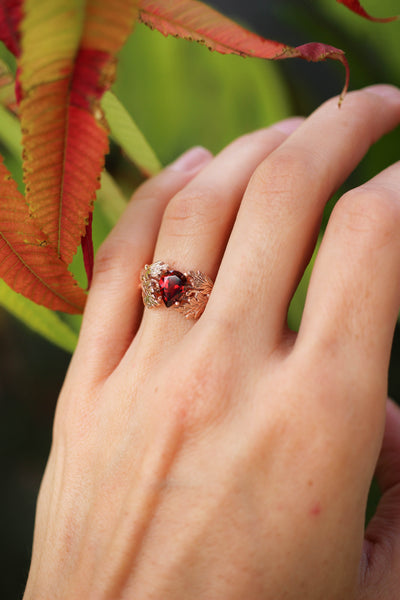 Maple leaves ring with pear cut garnet