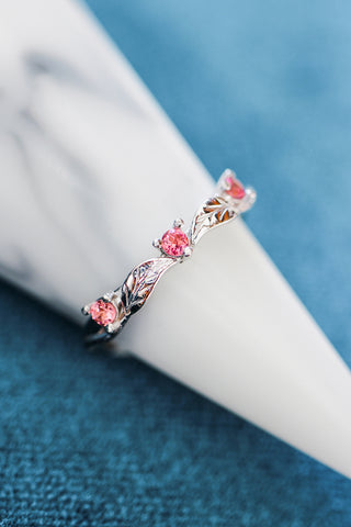 Three pink tourmalines wedding band