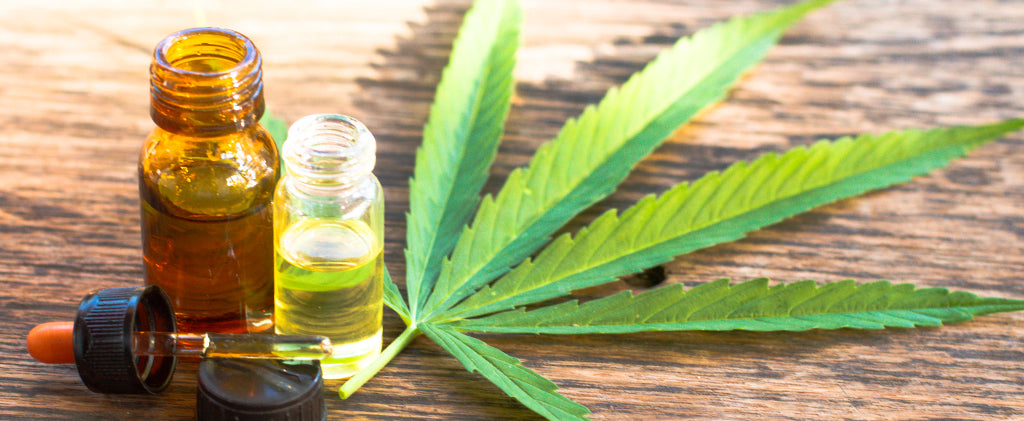 CBD oils and hemp leaf