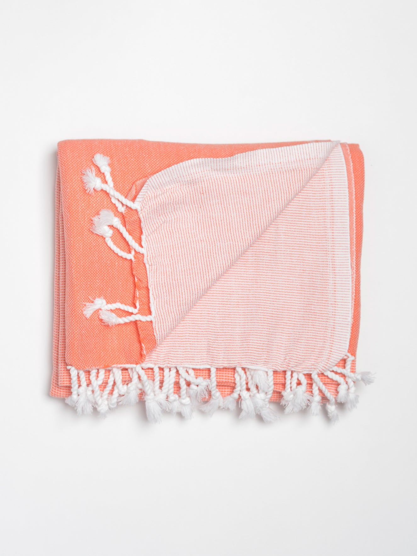 Beach and bath Turkish towel in a gradient coral to light coral colour