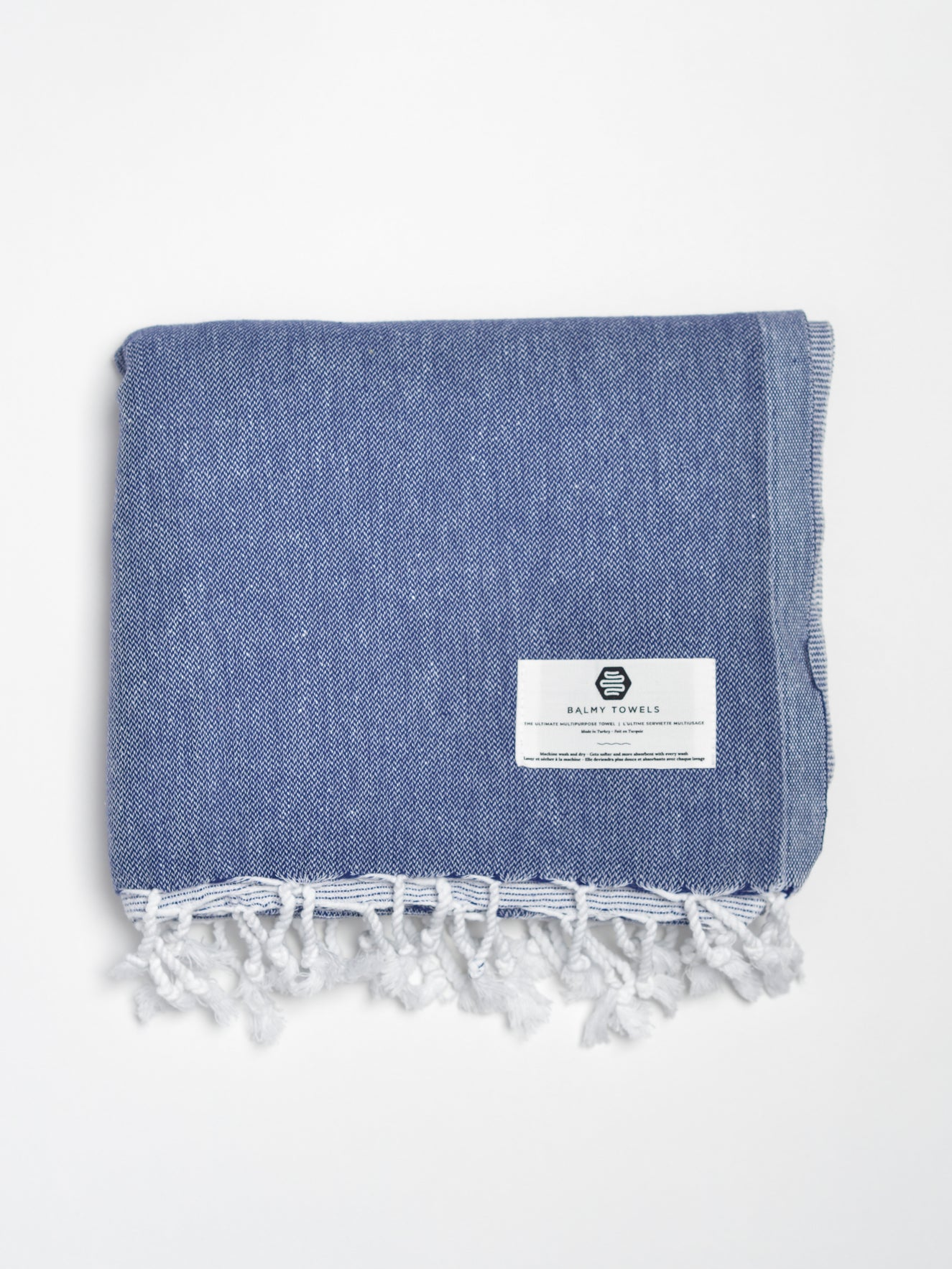 Beach and bath Turkish towel in a gradient navy blue to light blue colour