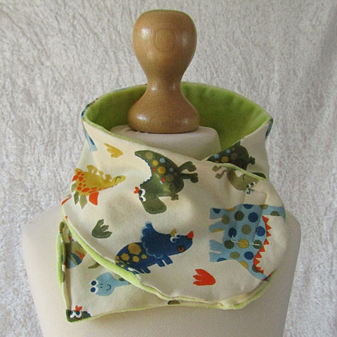 Cream Kids Scarf With Multi-coloured Dinosaurs, By JaDa Crafts Ireland - Parade Handmade