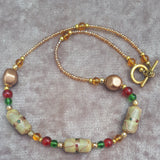 Necklace & Earring Set In Beige in Red and Green, By Lapanda Designs - Parade Handmade