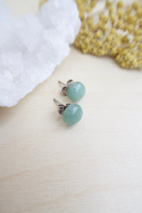 8mm Sea Green Aventurine on surgical steel posts sitting on a table
