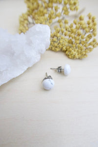 Simple white stud earrings on hypoallergenic skin friendly surgical steel posts