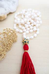 White freshwater pearl meditation mala with 108 beads and red tassel