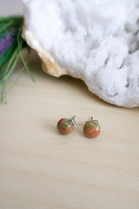 Simple everyday small green and pink gemstone stud earrings on surgical steel posts