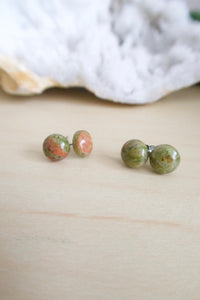 Green and pink gemstone studs on surgical steel posts