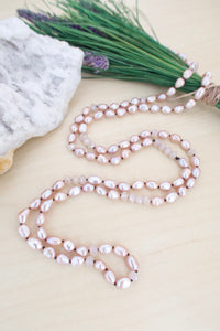 Long pink pearl strand with matching crystals