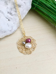 Wire crochet pendant with freshwater pearls woven in to look like a nest