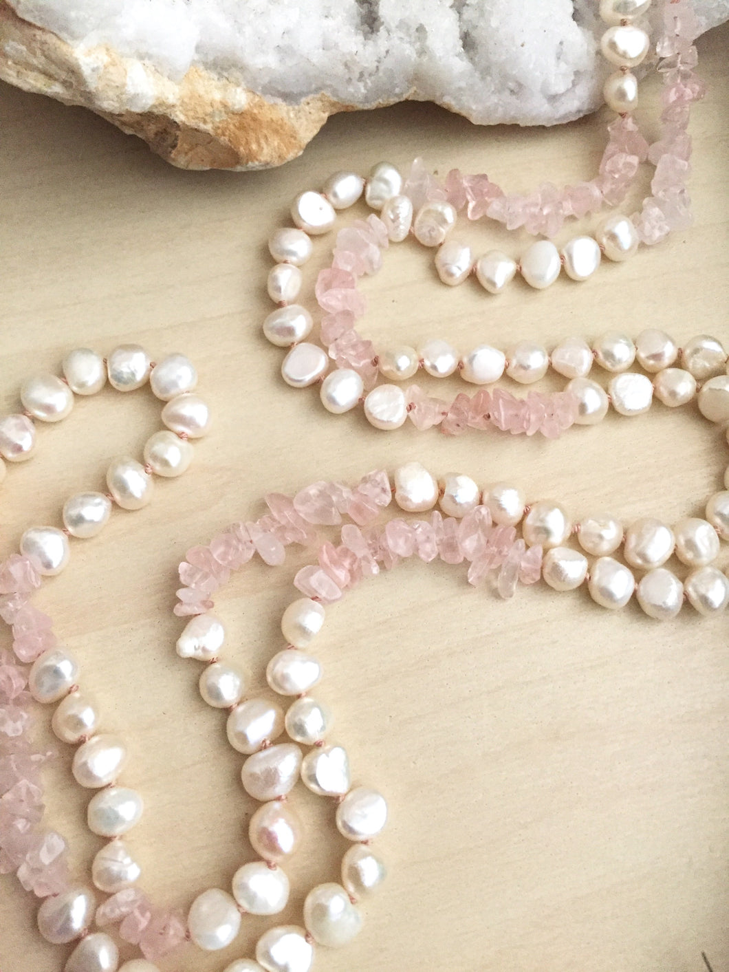 White freshwater pearls and rose quartz chips hand knotted on pink silk