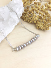 Load image into Gallery viewer, Grey freshwayer pearls arranged in a 1 inch horizontal bar and attached to a rhodium plated chain