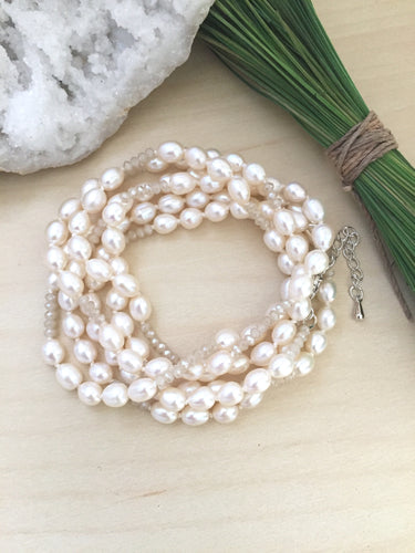 Cream freshwater pearls hand knotted with crystals and finished with lobster clasp.