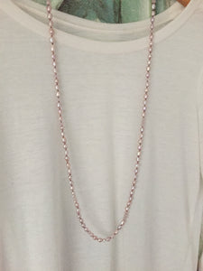 Soft pink freshwater pearl accented with matching crystals