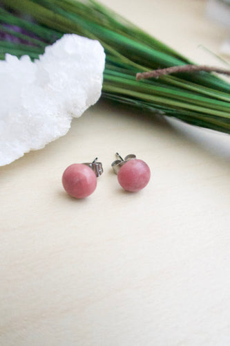 Soft pink gemstone stud earrings on surgical steel posts