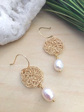 Load image into Gallery viewer, Top view of Round gold filigree disc earrings with a white freshwater pearl drop and on 14k gold fill ear wires