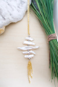 Long freshwater pearl ladder necklace with a gold chain tassel