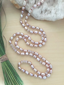 Feminine Pink Freshwater pearl hand knotted necklace