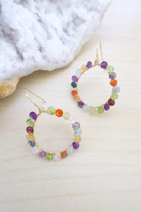 Hoop earrings with multi colored faceted gemstones