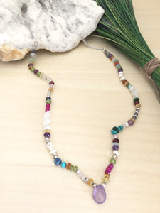 Bright Multi color gemstone necklace with a light purple amethyst focal drop
