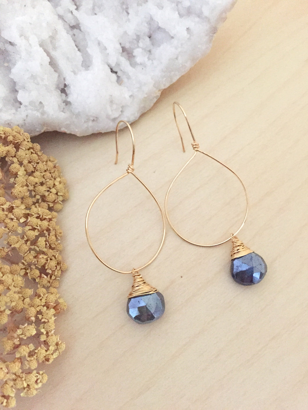 Gold fill hoop earrings with a wire wrapped black labradorite drop