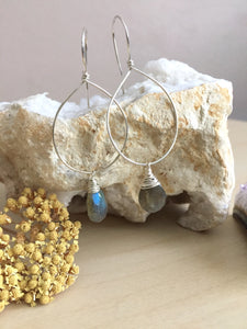 Sterling silver hoop earrings with a wire wrapped labradorite drop