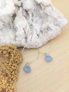 Sterling silver hoop earrings with a light blue chalcedony gemstone drop
