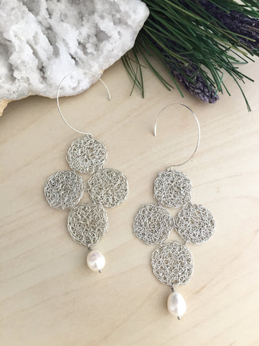 Sterling silver wire crochet quaterfoil design earrings with a white freshwater pearl drop