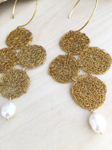 Brass wire crochet earrings pictured close up to show the details of the crochet weave