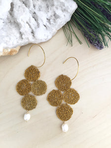 Wire crochet brass wire crochet earrings with a white freshwater pearl drop