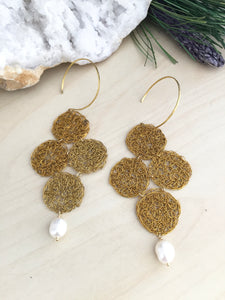 Raw brass wire crochet earrings with a hoop style ear wire and a white freshwter pearl drop