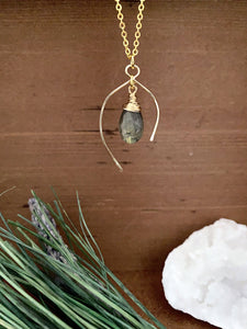 Labradorite gemstone drop necklace enclosed in a wish bone shaped frame