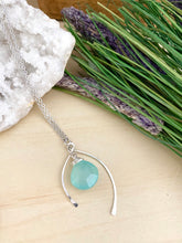 Load image into Gallery viewer, Aqua Blue Chalcedony pendant anclosed in a sterling silver wishbone frame and suspended from a 16 inch chain