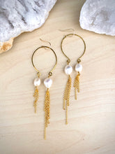 Load image into Gallery viewer, Inverted gold hoop earrings with white freshwater pearl drops and long gold chain tassels hung from 14k gold fill ear wires