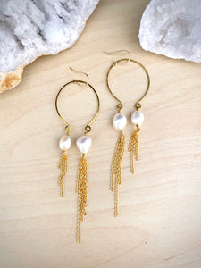 Inverted gold hoop earrings with white freshwater pearl drops and long gold chain tassels hung from 14k gold fill ear wires