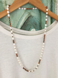 White freshwater pearl and wood necklace with brass accents
