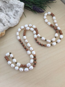 hand knotted pearl and wood strand