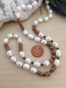 White and tan beaded necklace with freshwater pearls, wood and brass beads
