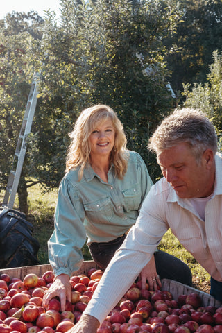Michelle and Wayne Sirles sort through freshly-picked apples at Rendleman Orchards in Southern Illinois.